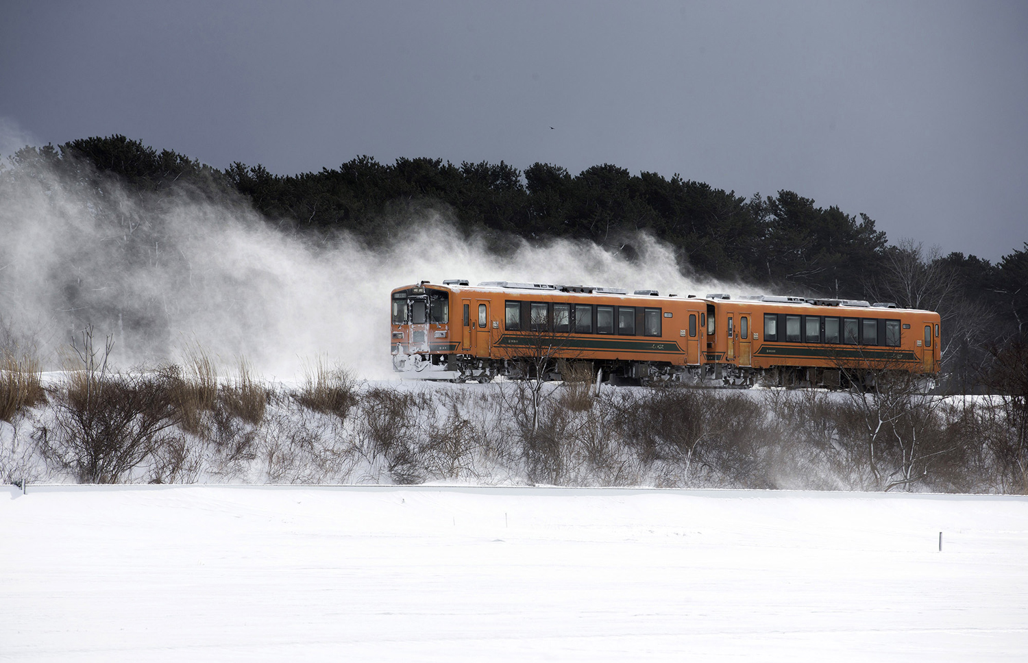 Potbelly Stove Train Passes Through Snow Field