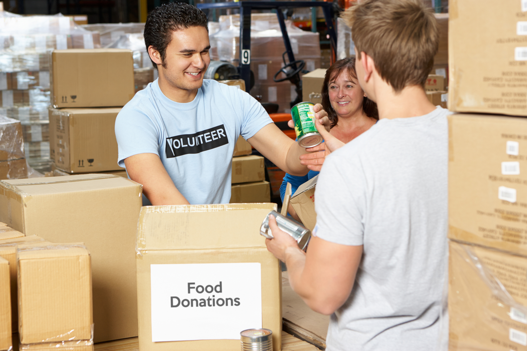 Food donations being boxed up by volunteers in a warehouse