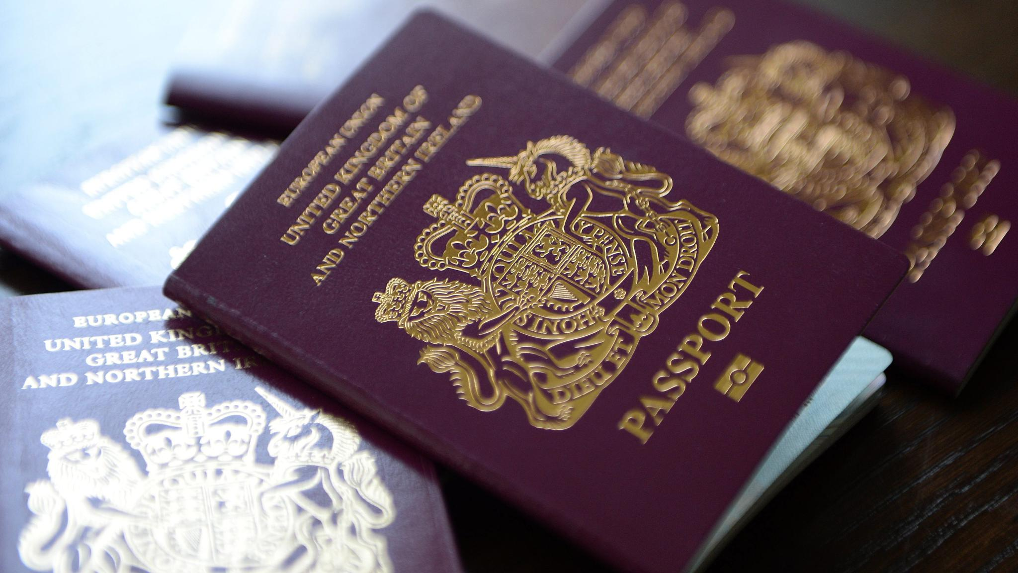 Government announces measures to help clear the backlog in passport applications...epa04253140 British passports in London, Britain, 13 June 2014. The Home Office has said on 12 July that to help clear the huge backlog of passport applications it will scrap charges for urgent renewals. Some 30,000 people have been impacted by the delays.  EPA/ANDY RAIN